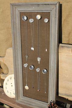 Cork board jewelry board I painted black used zebra duct tape