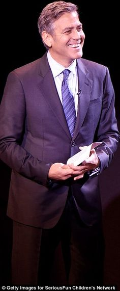 Inside the event: Clooney spoke onstage and continued to show off his beaming smile...
