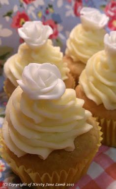 Honey bun cupcakes - a light honey cupcake with lemon and vanilla butter cream piped icing. To decorate, I made little white and dark chocolate bumble bees, made white sugar paste roses and iced the word honey...x