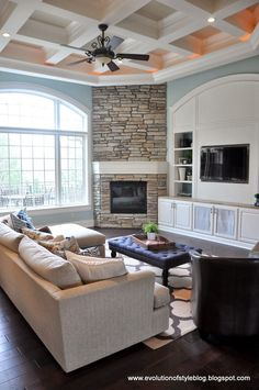 Love this ceiling detail with the stacked stone and TV layout - makes a lot of sense