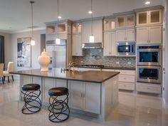 Designed by The Design Firm in Stafford, Texas #interiors #interiordesignideas #design #interiordesign #interiordesigners #kitchen #kitcheninspiration #kitchenisland #backsplash
