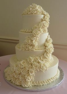 cake!  Love the flowers but would def have to use the color theme of my wedding on the part that lines each layer!