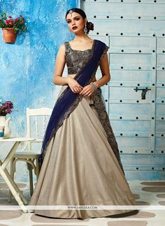 Vogue and pattern would be on the peak of your elegance after you dresses this navy blue jacquard silk and net a line lehenga choli. You could see some fascinating patternscompleted with embroidered...
