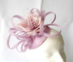 Fascinator hat - dusky pink, feathers flower and sinamay. £47.00, via Etsy.