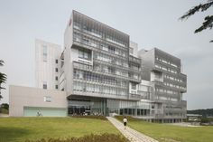 Built by Kyu Sung Woo Architects in Daejeon, South Korea with surface 26023.0. Images by Goongsun Nam . Located in a suburb of Daejeon, Korea, the campus is comprised of buildings scattered throughout a lush setting of tr...