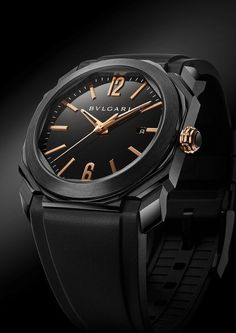 The @bulgari Octo Ultranero Solotempo, powered by Caliber BVL 193, has a 41-mm diameter stainless steel case treated with black DLC, an 18k rose gold winding crown with a black ceramic insert and hand-applied, rose-gold-plated hands and hour indices on the black lacquered dial. It comes on a rubber strap and is shown with black DLC bezel.  More @ http://www.watchtime.com/wristwatch-industry-news/watches/bulgari-octo-ultranero-collection/ #bulgari #watchtime #menswatches #baselworld2016