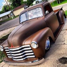 Chevy Chevrolet Advanced Design pickup truck laid out slammed on ball milled solid wheels and dressing a smooth satin brown root beer paint finish.