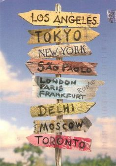 sign post for the garden. create one pointing to our favorite places on earth.