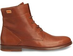Woody comes as a brown mid-cut lace up boot made of full grain leather with a waxed finish.