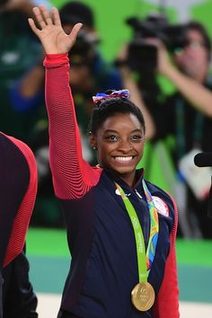 #RIO2016 US gymnast Simone Biles celebrates on the podium during the women's team final Artistic Gymnastics at the Olympic Arena during the Rio 2016 Olympic...