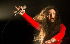 Royal red. Lorde mesmerizes during a performance on Oct. 18 in Sydney