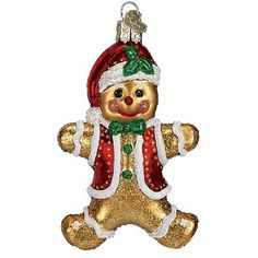 """Gingerbread Boy Christmas Ornament 32164 Merck Family's Old World Christmas Introduced 2011 Measures approximately 4"""" Made of mouth blown, hand painted glass. Cheerful Gingerbread"""