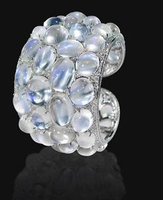 Moonstone and Diamond; 47 total weight of 490 karats of Moonstone; 833 total weight of 17.84 karats of round diamonds  This aesthetic and romantic works of jewelry from the Anna Hu