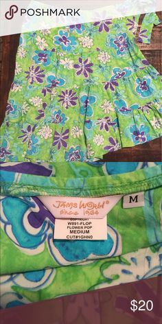 Bright and colorful asymmetric skirt Flip, flop, flower pop! Lime, turquoise, and purple asymmetric skirt. Ties on the side. 100% rayon, but feels like cotton. Excellent condition. Great with a t-shirt or bathing suit. Skirts Midi