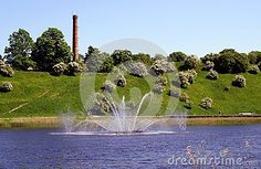 Talsi city lake is situated near the foot of beautiful blooming hill  A view from one side of the lake to another one