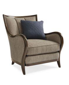 Оригинальное и  стильное мягкое кресло из коллекции Taylor. Прекрасная нейтральная обивка дополнена яркой синей подушкой.             Метки: Кресла для дома, Кресла с деревянными подлокотниками, Кресло для отдыха.              Материал: Ткань, Дерево.              Бренд: Schnadig.              Стили: Классика и неоклассика.              Цвета: Бежевый.