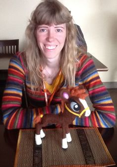 Jennifer Wood (www.artofjwood.com) is the artist of The Year of the Horse. She is also very crafty! Here she is with her one-of-a-kind feltie of Hannah, the heroine of the 9th story of the Tales from the Chinese Zodiac. Jennifer Wood, Year Of The Horse, New Children's Books, Chinese Zodiac, Felt Diy, Childrens Books, Horses, Crafty, Artist