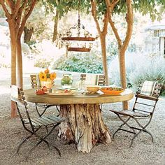Repurposed Dining Tables - we should look for a large dry stump & make this w/ our electric cable spool top