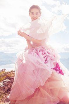 Liu Shishi in pink floral dress for wedding photo