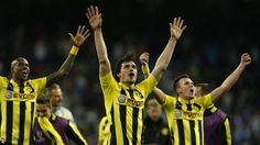 Borussia Dortmund survived a frantic finish at the Bernabeu to reach the Champions League final despite two late goals by Real Madrid.