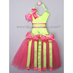 Hot Pink with Lime Lace Tutu Hair Bow Holder  Hot Pink with Lime Lace Tutu Hair Bow Holder  Hot Pink and Lime are a gorgeous color combo.  Add them to a bow holder and organizer shaped like a tutu and you've got the formula for a beautiful decorative piece for your little girls room.  Clip your little girl's hair bows and flowers ...