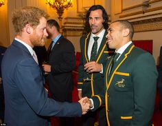 Prince Harry with South Africa's Victor Matfield, centre, and Bryan Habana, who will meet Wales in the quarter finals. 10/1/2015