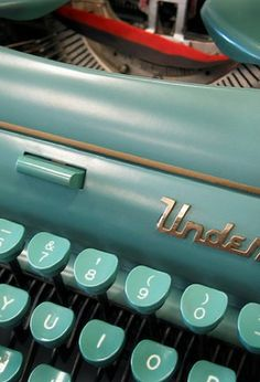Vintage Typewriter.  I received one of these for my high school graduation present from my parents. - I love these colors!