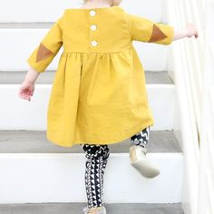 Triangle leather elbow patches on this twirly tunic, tribal knit baby leggings, and hand sewn baby shoes.