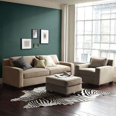 Wow. Just wow. Benjamin Moore's Lafayette Green. The black and white rug is an amazing accent to the green!