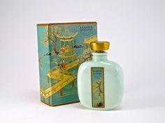 1927 A. Jollivet, Pleville Plaisir d'Orient perfume bottle, opaque green glass (dragon molded on reverse), gilt glass stopper, label, drawer-slide box (missing tassel). Molded Jollivet mark. 3 1/4 in.