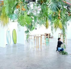Hanging jungle installation by Loose Leaf.  Love this idea of hanging things from the ceiling, bathroom at Suzies?