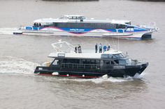New to the Thames charter vessel 'Imperial Odette' with 'Monsoon Clipper' in the background
