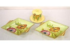 PAIR OF ART DECO CARLTON WARE SHAPED DISHES decorated with gilt borders in the Iceland poppy patt