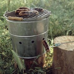 BucketBBQ  The perfect thing for easy dinners in the garden, picnics on the beach and romantic suppers anywhere. This lightweight galvanised barbeque bucket with wooden carrying handle keeps charcoal and ashes safely contained. Very easy to light and makes clean-ups a doddle.