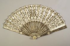 Pleated fan  European, ca. 1790s  Silk satin leaf embroidered with sequins and carved ivory sticks and guards   Anonymous gift, KSUM X2004.2