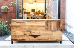 The #HotelHealdsburg prototype credenza, built in the #DBA_workshop with wrapped grain solid salvage Bay Laurel from #EvanShively's #Arborica. #DavidBakerArchitects #dbarchitect #DBAinside