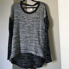 Brand new with tags LF key whole sweater Brand new LF key whole sweater with tags attached!!! So cute :) black and white size small! LF Sweaters Crew & Scoop Necks