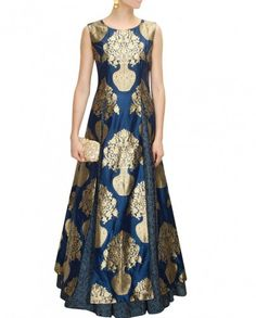 1. Dark Blue Raw Silk long kurti and skirt 2. Highlighted with golden patches on kurti 3. Raw silk kurti and printed long skirt 4. Can be stitched up to size 42