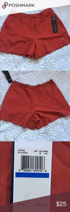 Fila tennis shorts NWT Burt orange xl NWT buttons in front it has an electric in the back like a burnt orange color size xl Fila Shorts
