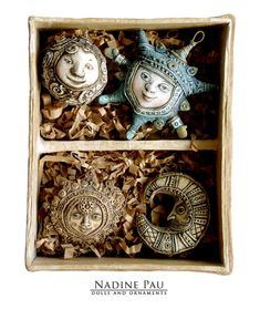 "by Nadine Pau Christmas ornaments. ""Parcel post from the past."" Papier mache, oil patina varnish. sold #christmasornaments #nadinepau"