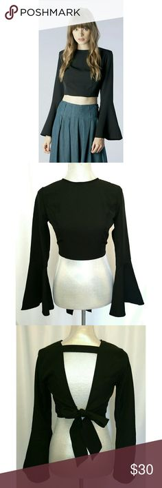 Bell Sleeve Crop Top Bell Sleeve Crop Top with open back and tie. Great with a high waist pant, skirt or jeans!  NWT  Content: 95% POLYESTER 5% SPANDEX Mustard Seed Tops Crop Tops