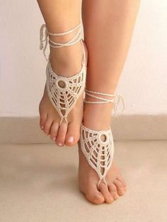 The Lasunka Crochet Ivory Barefoot Sandals are Delicate #photoshoots #fashion trendhunter.com