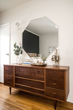 Love the mirror shape above the side board