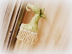 fantasy tassel . one of a kind vintage by UnfinishedBusiness (Home & Living, Home Décor, home decor, fantasy tassel, decorative tassel, handmade, vintage salt shaker, leafy boot, woodland fairy boot, salt shaker upcycle, minty green tassel, aged fringe, rayon fringe, cotton fringe, bullion fringe)