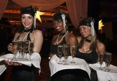 flappers passing champagne.