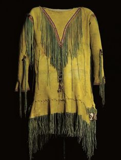 """Southern Plains beaded and fringed hide ghost dance shirt. Decorated with yellow ochre. The hide is painted in red and green pigments with birds, probably crows, circles and """"idiosyncracies"""" on the front and a cluster of stars on the back. Native American Shirts, Native American History, Native American Fashion, Native American Indians, Plains Indians, Cowboys And Indians, American Indian Art, American Traditional, Dance Shirts"""