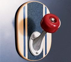 """[Gift Idea] With the streamlined shape of a real skateboard wheel, our skateboard peg turns storage into a fun display. Assembly required. Keyhole mount. 5 x 4.5 x 7"""" h. Internet Only. Buy Now 