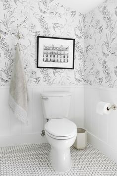 A whimsical, neutral kid's bathroom with mixed metals and wallpaper | Studio McGee Blog