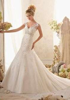 Style Number: 2622 Delicate Embroidered Appliques on Net, Edged with Crystal Beading Wedding Dress The...