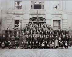 June 1916 - Liberty Hall after The Rising. A gathering of Irish Citizen Army, ITGWU, and Labour Party members with heads held high outside Liberty Hall. The building was badly damaged after the shelling by the British gunship during the Easter Rising. Easter Rising, Labour Party, Dublin Ireland, Women In History, Party Photos, Old Photos, Irish, Street View, Explore